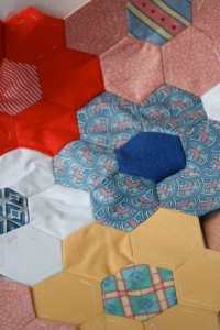 multi coloured pentagonal quilt