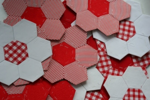 red and white pentagonal  quilt