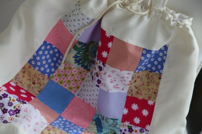 patchwork panel on bag front