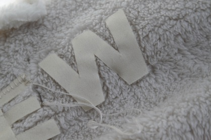 letters appliqued onto fleece