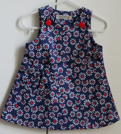 navy, white and red daisy pinafore
