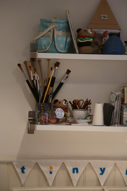 paint brushes, needles, buttons, lace bobbins.....