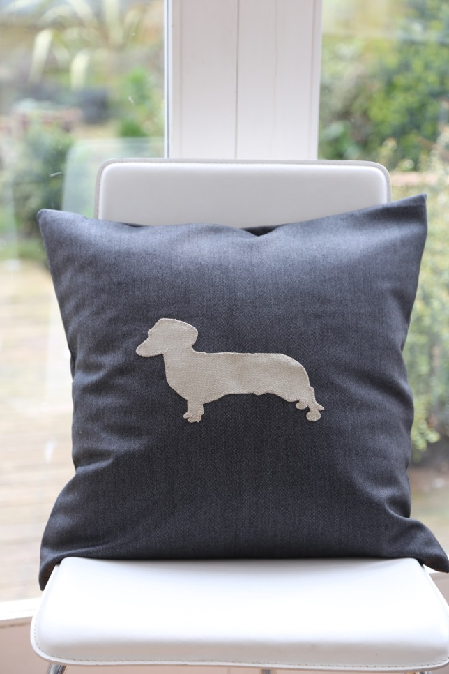 grey gaberdine cushion with stone coloured daschund