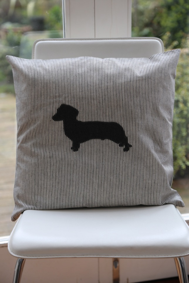 grey striped linen cushion with grey daschund