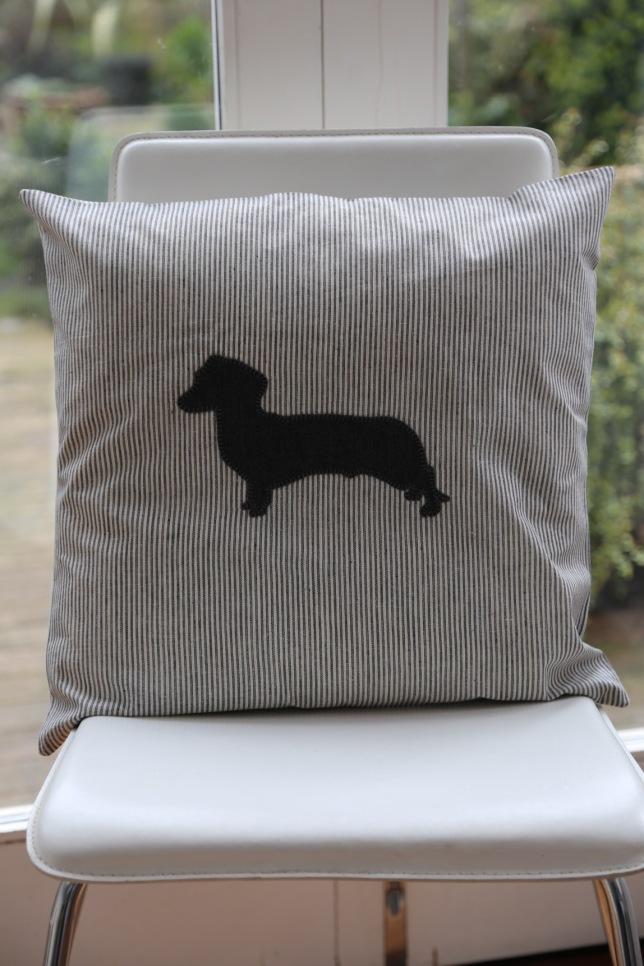 grey striped linen cushion with grey daschund